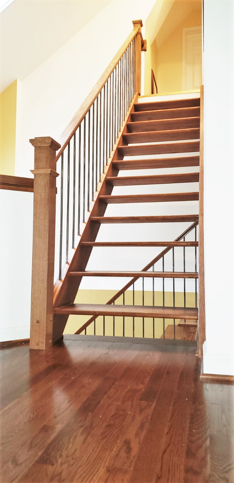Floating Oak Stairway with Metal Balusters