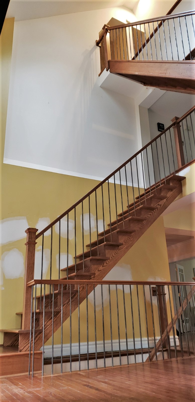 Floating Oak Stairway with Stainless Steel Balusters